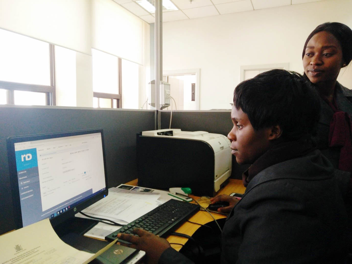 Stenographer Ms. Jean Mwenfa Simukonda gives out an export permit using the digital interface