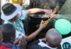 President Edgar Lungu cuts the ribbon to officially handover two Higer buses to a youth group in Kasama today.This was shortly before addressing a mega rally at Kasama Golf Course.-picture by Mary Bwembya (ZANIS).