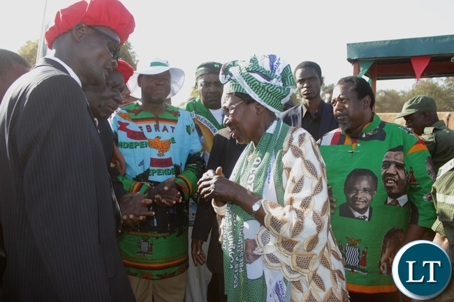 PF Presidential Running Mate, Vice President Inonge Wina (c) talking to Barotse Royal Establishment Indunas as PF Mangango Constituency aspiring candidate Robert Chiseke (in white hat) and Kaoma Central Constituency aspiring candidate Austin Liato (r) look on after a rally at Kaoma Airstrip in Western Province