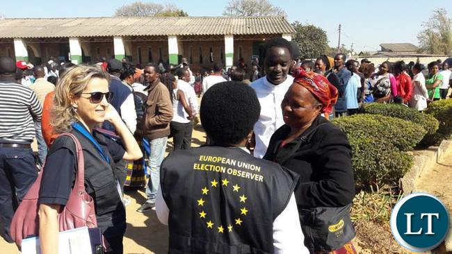 EU EOM Zambia Chief Observer Cecile Kyenge talks to voters  waiting to cast their votes-in Lusaka.