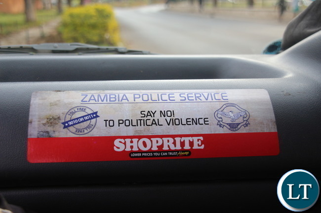 Zambia Police stickers and billboard sensitising people not to resolve to violence motivated by politic sentiments. Courtesy of Jean Mandela