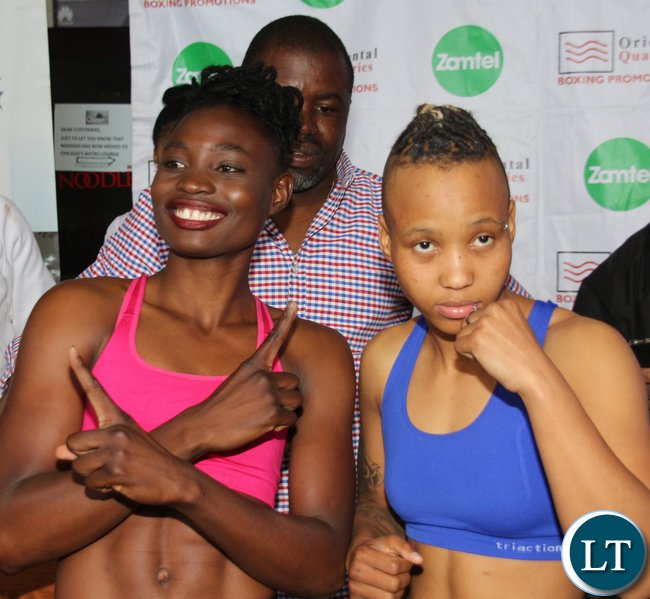 WBC Bantamweight Champion Catherine Phiri with the title challenger south African boxer Gibisile Tsabala during the weigh in at Chicago Restaurant at Manda Hill in Lusaka