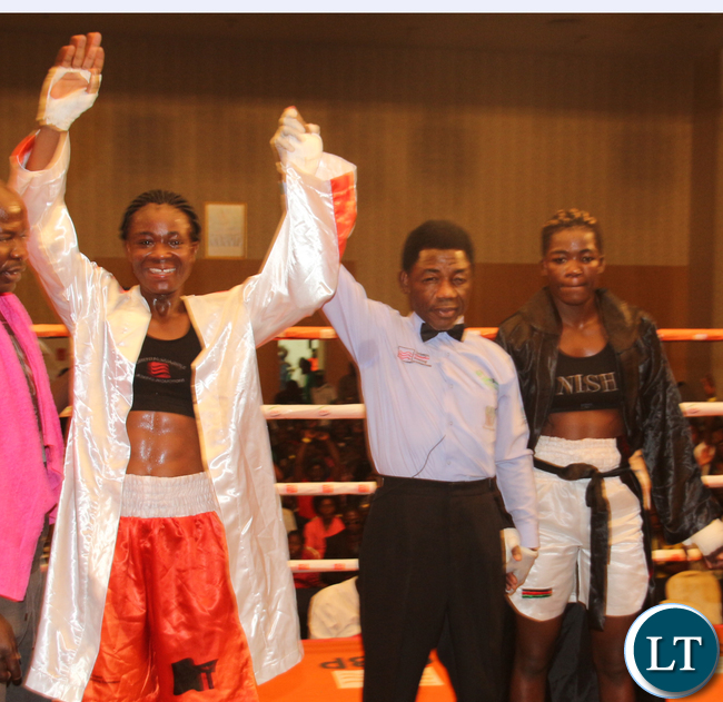 Zambia Lolita Muziya fighting Malawian lady boxer Anisha Bashit during the Welterweight not title fight bout, Lolita won the fight,