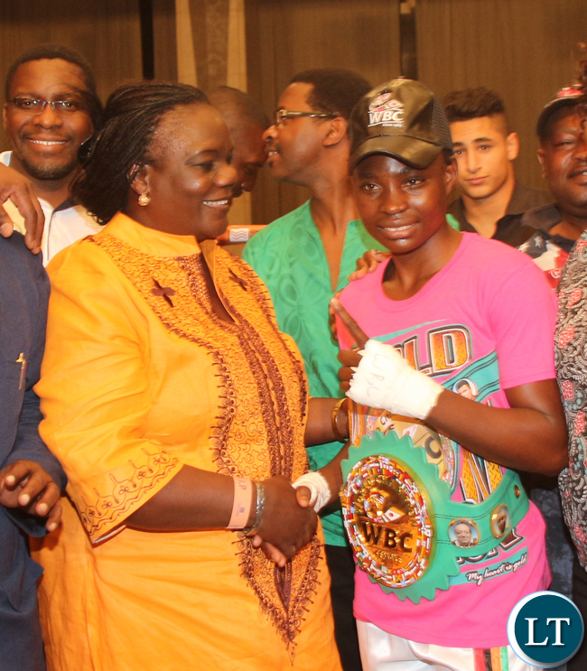 Ministery of Sport, Youth and Child Development PS Agnes Musunga congratulating Phiri Catherine