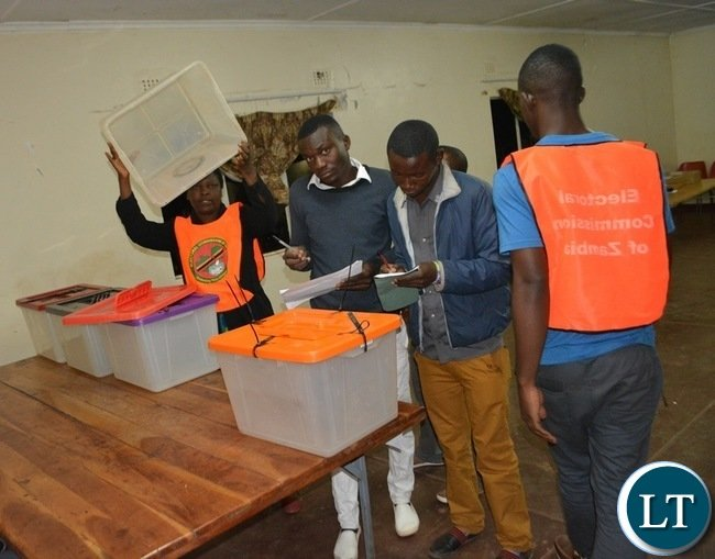 Electoral officers, agents and monitors inspecting the Ballot Boxes at Rainbow Africa polling station in Livingstone yesterday shortly before the opening of the Polls yesterday. Picture by BRIAN HATYOKA