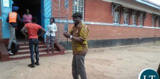 Green party aspirant candidate peter sinkamba accompanied by his wife found casting his vote at Rokana polling station in Nkana constituency. Pictures by Sylvia mweetwa