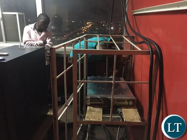 ZICTA officials switching off Komboni transmitters at Indeco House last night