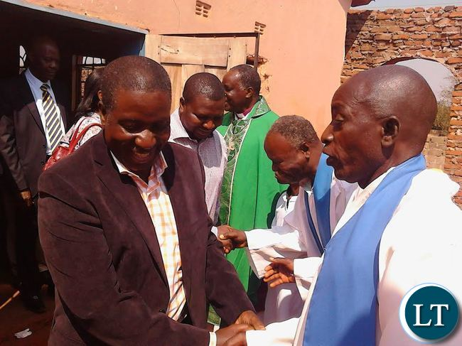 Mutolo Phiri greeting church officials after church service on Sunday.