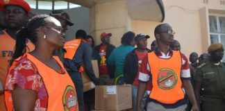 Livingstone District Electoral officer Vivian Chikoti (left) and other electoral officers supervising the offloading of ballot papers and other election materials at the Civic Centre
