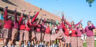 Kabulonga Girls' School students celebrating the a talk by SABMiller on the dangers of underage drinking.