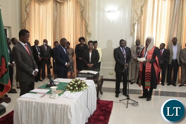 Newly appointed Speaker of the National Assembly Patrick Matibini taking orth before President Edgar Lungu during swearing in Ceremony