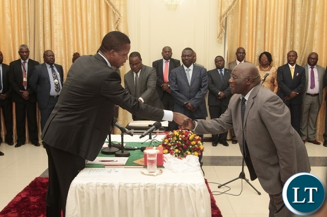 President Edgar Lungu congratulates Newly appointed Minister of General Education Dennis Wachinga during swearing in ceremony at State House