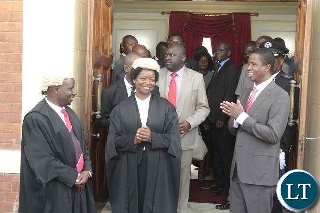 President Edgar Lungu chats with Newly appointed First Speaker of the National Assembly Catherine Namugala (2nl) and second Speaker of the National Assembly Mwemba Malama (l) shortly after swearing in Ceremony at State House