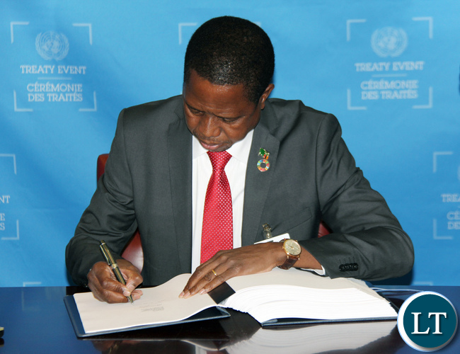 President of Zambia His Excellency Mr. Edgar Chagwa Lungu signing the Paris Agreement on Climate Change during the UN Treaty Signing Event at the on-going High-Level Segment of the 71st Session of the United Nations General Assembly in New York USA on Tuesday 20 September 2016. PHOTO | CHIBAULA D. SILWAMBA | ZAMBIA UN MISSION