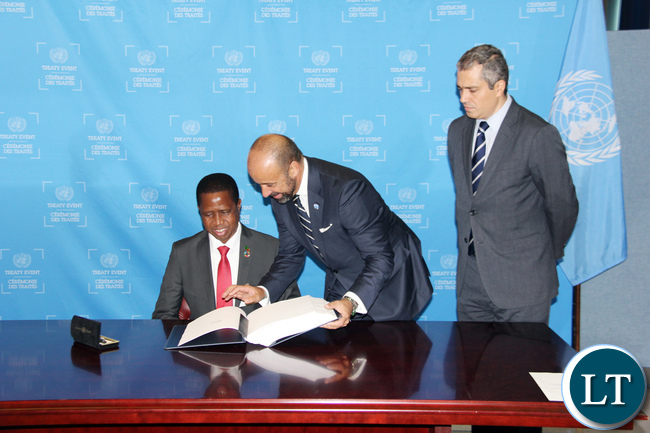 United Nations Under-Secretary-General for Legal Affairs and Legal Counsel Miguel de Serpa Soares (r) showing the President of Zambia His Excellency Mr. Edgar Chagwa Lungu where to sign during signing ceremony for the Paris Agreement on Climate Change at UN HQ in New York USA on Tuesday 20 September 2016. PHOTO | CHIBAULA D. SILWAMBA | ZAMBIA UN MISSION