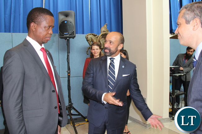 President of Zambia His Excellency Mr. Edgar Chagwa Lungu talking to United Nations Under-Secretary-General for Legal Affairs and Legal Counsel João Miguel Ferreira de Serpa Soares (c) and UN Treaty Section Chief Santiago Villalpando when the Head of State went to sign the Paris Agreement on Climate Change at UN HQ in New York USA on Tuesday 20 September 2016. PHOTO | CHIBAULA D. SILWAMBA | ZAMBIA UN MISSION