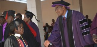 Zambia News and Information Officer (ZANIS) Livingstone Information Officer Angela Mwandu (left) and Rusangu University Vice Chancellor Pardon Mwansa (right) after she received her Bachelor of Arts Degree in Journalism and Communication during the 10th Graduation Ceremony for Rusangu University in Monze