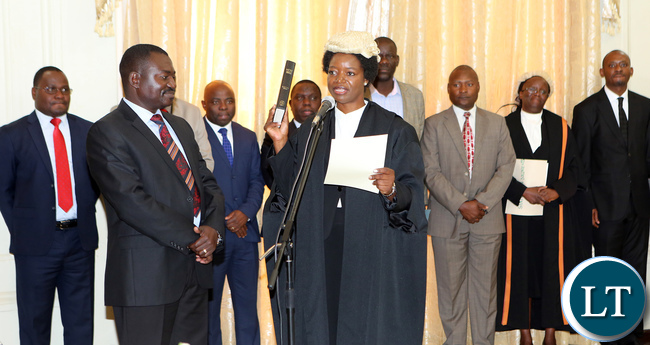 Newly appointed first Speaker of the National Assembly Catherine Namugala taking orth before President Edgar Lungu during swearing in Ceremony