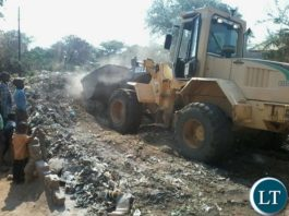 A Livingstone City Council(LCC) grader clearing garbage in Livingstone's Maramba compound