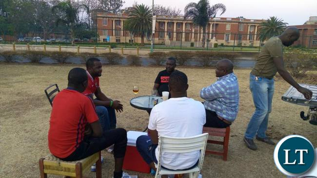 Max, Kennedy Kamba and other PF cadres enjoying their beer outside the Supreme Court