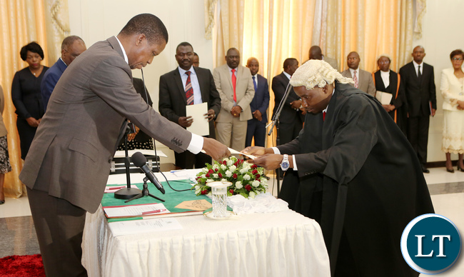 Newly appointed second Speaker of the National Assembly Mwemba Malama taking orth before President Edgar Lungu and his Vice President Inonge Wina during swearing in Ceremony