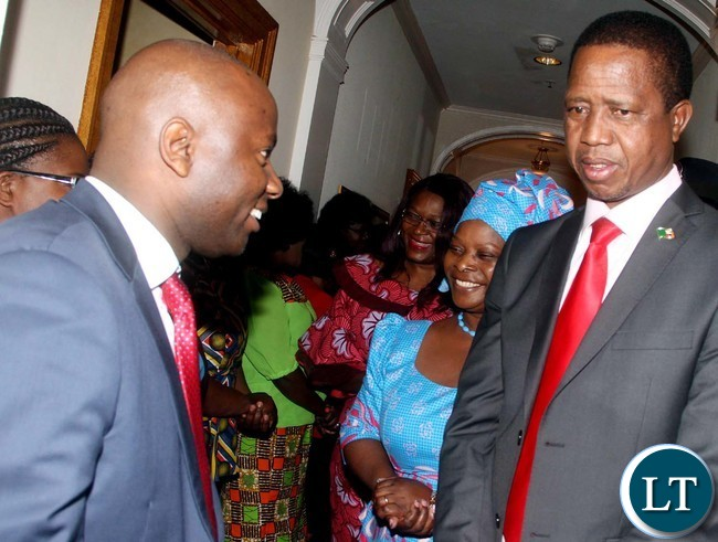 President Lungu and First Lady Esther Lungu listens to Permanent Mission of Zambia to the United Nations First Secretary for Press Chibaula Silwamba on arrival in New York for the 71st UN General Assembly on Friday, September 16,2016-Picture by THOMAS NSAMA
