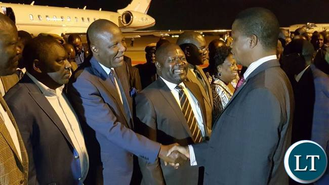 President Lungu being welcomed by Minister of Finance Felix Muatati