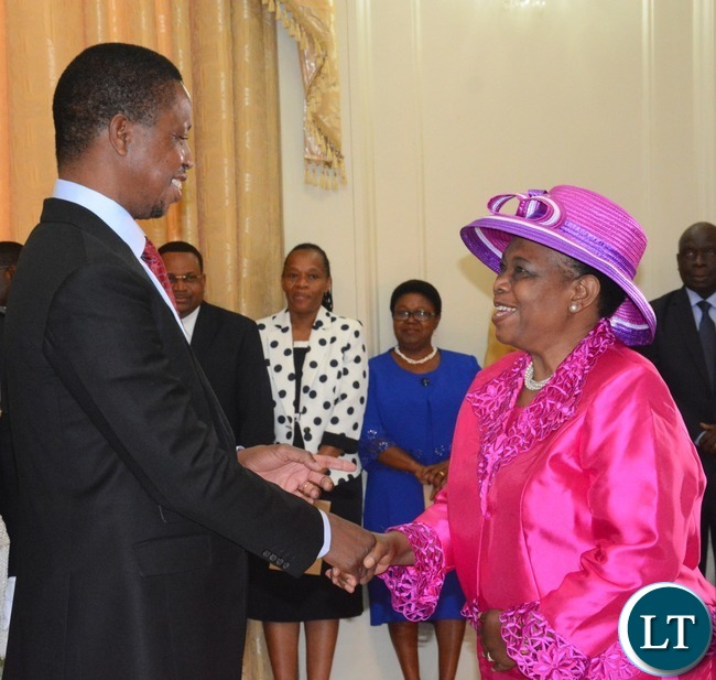 President Edgar Lungu(l) congratulates Godfridah Sumaili after the swearing in ceremony at State House