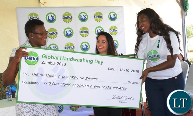 Triple Eight Managing Director Sarika Modi(c) and South African Dettol Ambassador Leorna Moya(r) handover 200,000 Bar soaps for the Mothers and Children of Zambia to Ministry of Health Mother and Child Director Caroline Phiri(r) during  Giacomo Global Hand Washing Day at North mead Primary School