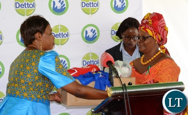 First Lady Esther Lungu(r) donates 44 sports kit and 4 balls to North mead Primary School Headmistress Sylvia Mulyata(l) on behalf of the School during  Giacomo Global Hand Washing Day at North mead Primary School