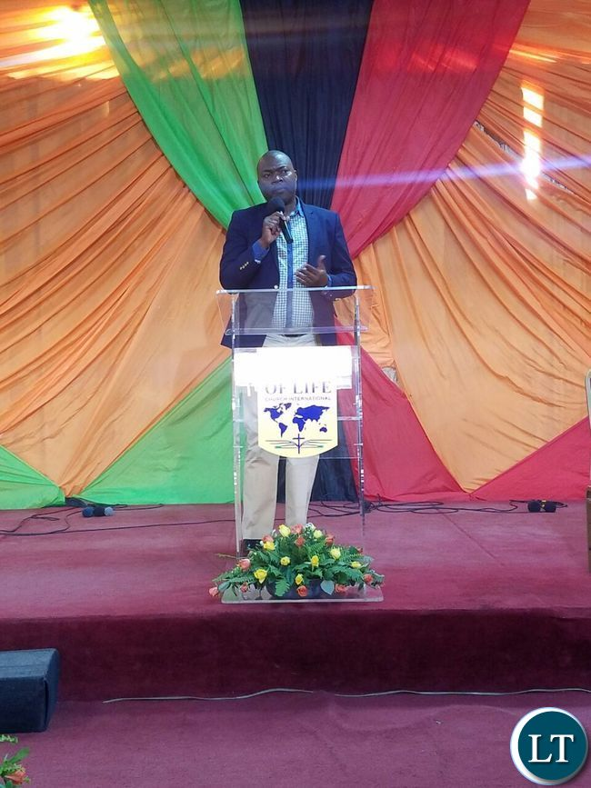 Addressing congregants at Bread of Life Church Ndola Main Branch