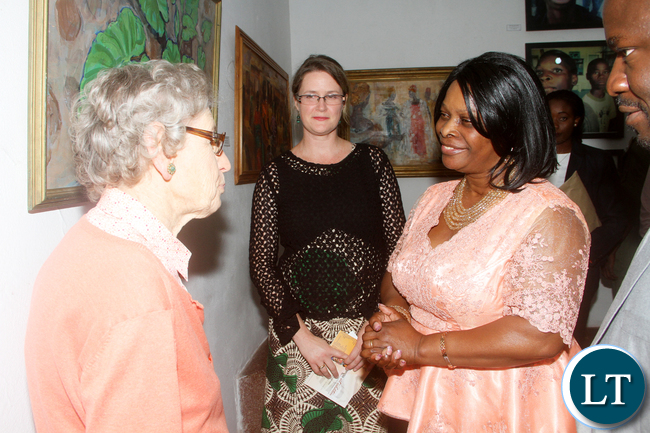 First Lady Esther Lungu speaks with Cynthia Zukas during the official opening of the National Women's Art Exhibition at Henry Tayali Visual Arts center at Show grounds in Lusaka on Tuesday, October 4,2016 -Picture by THOMAS NSAMA