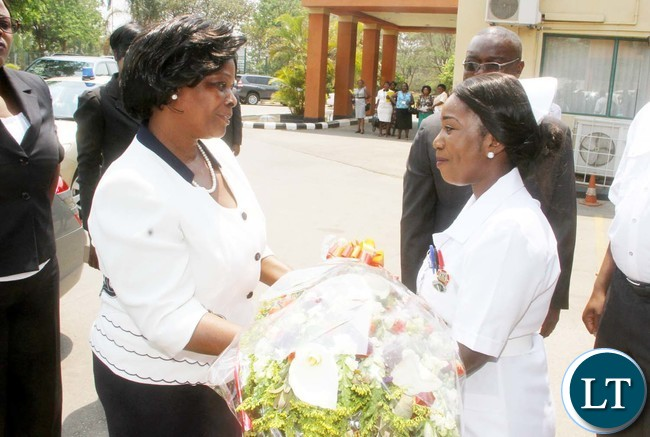 First Lady Esther Lungu receives bouquet flowers from Racheal Sikabankani on arrival at Cresta Hotel for the Commemoration of World Mental Health Day in Lusaka on Monday, October 10,2016-Picture by THOMAS NSAMA