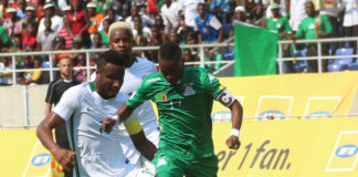 Rainford Kalaba and Mikel John Obi fight for the ball