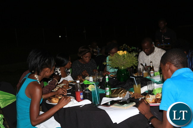 Some members of the media enjoying their dinner