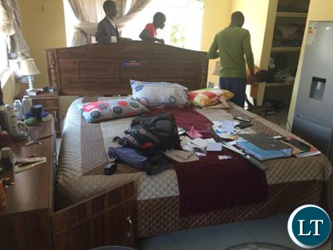Police officers processing Dr Chishimba's bedroom