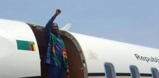 President Lungu waves the PF party symbol as he left the country for Madagascar