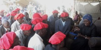 Vice President Inonge Wina (r) interacts with Barotse Royal Establishment (BRE) Indunas shortly after the burial of His Royal Highness the late Chief Lukama Meebelo Sekeld of Sioma and Shangombo Districts at Ibolokwa area of Nalolo District in Western Province