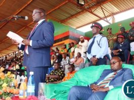 EASTERN Province Minister, Makebi Zulu, addresses the gathering at this year's Independence celebrations held at David Kaunda Stadium in Chipata. Next to him is Youth , Sport and Child Development Minister, who is also Member of Parliament for Chipata Central, Moses Mawere. PICTURE BY STEPHEN MUKOBEKO/ZANIS