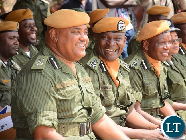 Police Commissioners, Commissioner A. Daka (l) Commissioner C. Bowa (c)and Commissioner B. Kapeso following the Parade proceedings during the 2015-2016 Pass out Parade in Geoffrey Mukuma Training School or called Sondela in Kafue District