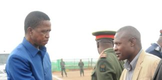 President Edgar Lungu(l) greets Patriotic Front Deputy Spokes Person Frank Bwalya(r) before departure for Morocco at Kenneth Kaunda International Airport in Lusaka