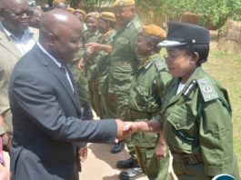 Minister of Home Affairs Stephen Kampyongo shake hands with Central Province Police Commissioner Lombe Kamukoshi shortly after the 2015-2016 Pass out Parade in Geoffrey Mukuma Training School or called Sondela in Kafue District