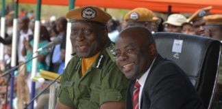 Minister of Home Affairs Stephen Kampyongo and Inspector General of Police Kakoma Kangaja following the Parade proceedings during the 2015-2016 Pass out Parade in Geoffrey Mukuma Training School or called Sondela in Kafue District