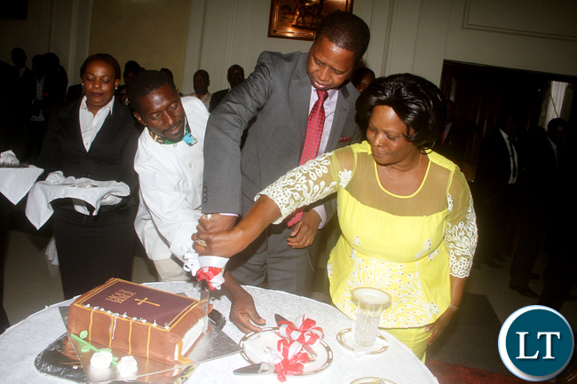 President Edgar Chagwa Lungu Being Helped To Cut A Cake By First Lady Esther During
