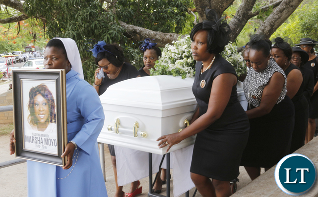 Former Roma Girls pupils as pallbearers of a casket carrying the remains of the late Masha Moyo prior to the memorial service; the ceremony took place at the Lusaka Holy Cross Cathedral