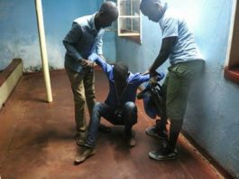 Njenje Chizu failing to walk after he was released from police cells