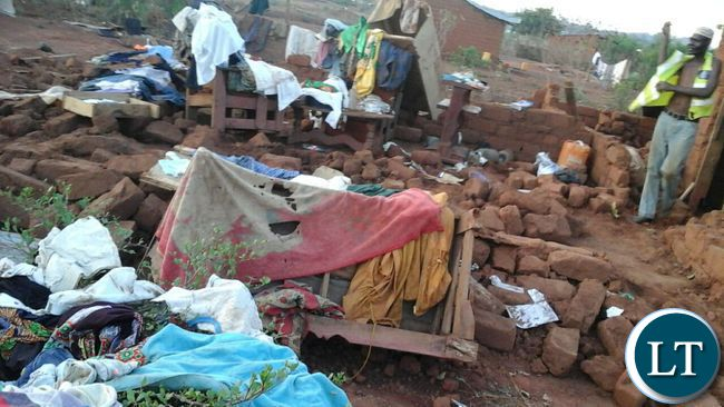 Remains of a house damaged by a recent rainstorm in Ndola