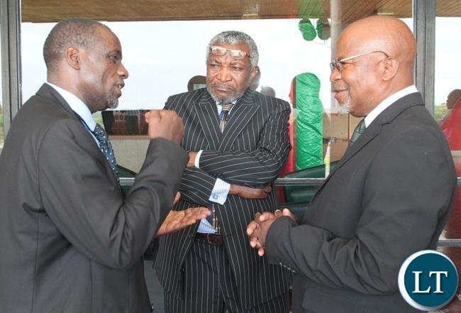 Former Finance Minister ,Katele Kalumba(left) confers with Mangande Mwanajiti before the presentation of 2017 budget in Lusaka.Looking on is Patrick Kalifungwa.