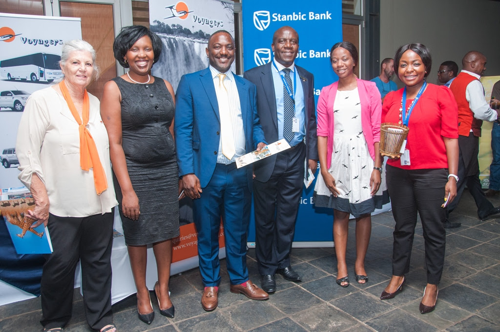 Stanbic Bank Zambia Chief Executive Charles Mudiwa, centre, and Head of Personal and Business Banking Mukandi Chibesakunda, second left, with Chichele Presidential Lodge prize winner Rodney Sikumba, Voyagers Manager Molly Care, Stanbic Public Relations and Communications Manager Chanda Chime-Katongo, right.