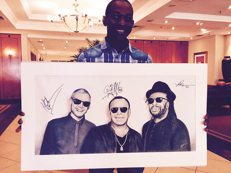 23-year-old Lusaka artist Silvester Mali with his drawing of UB40, being auctioned by Stanbic Bank to raise money for charity.